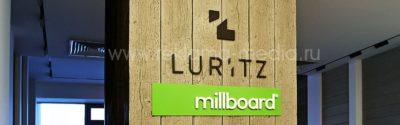 3D логотипы в интерьере шоу-рума с продукцией от TVR, LURITZ, Millboard и Новый интерьер